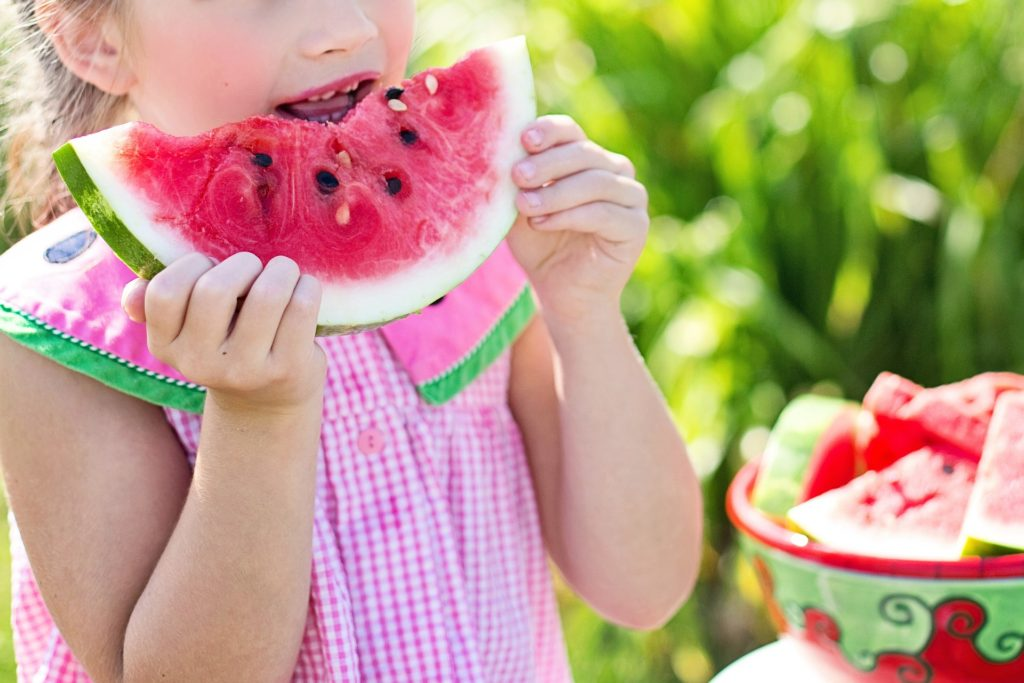 little girl eating watermelon